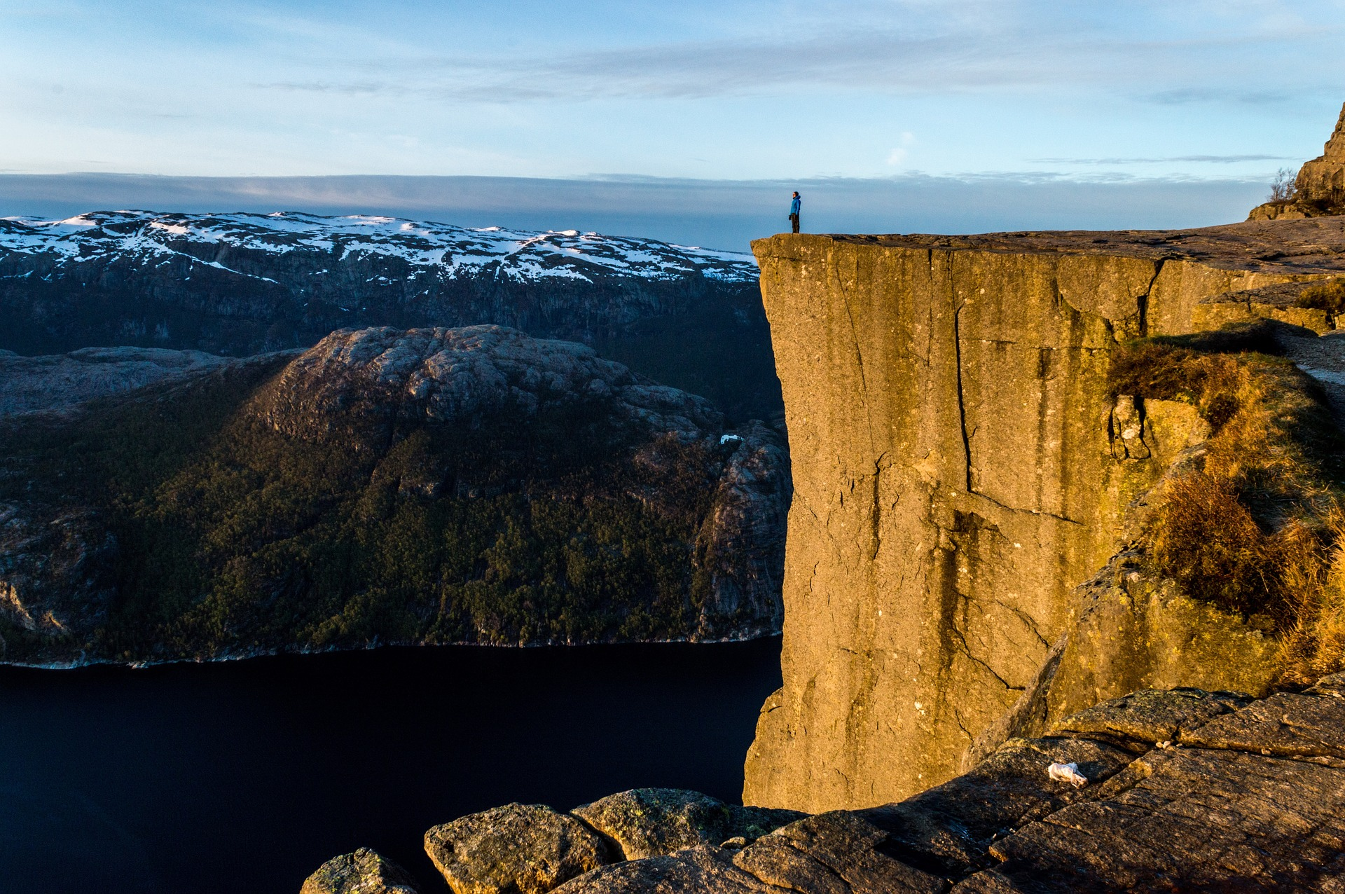 a man standing on a plateau in Norway
