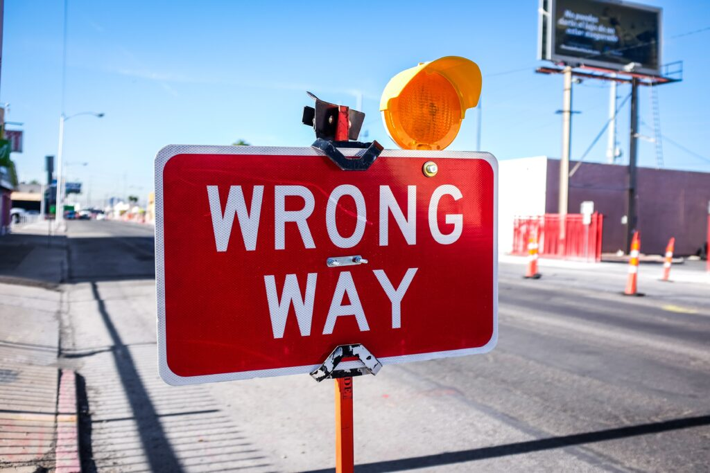 """a red sign saying """"wrong way"""""""