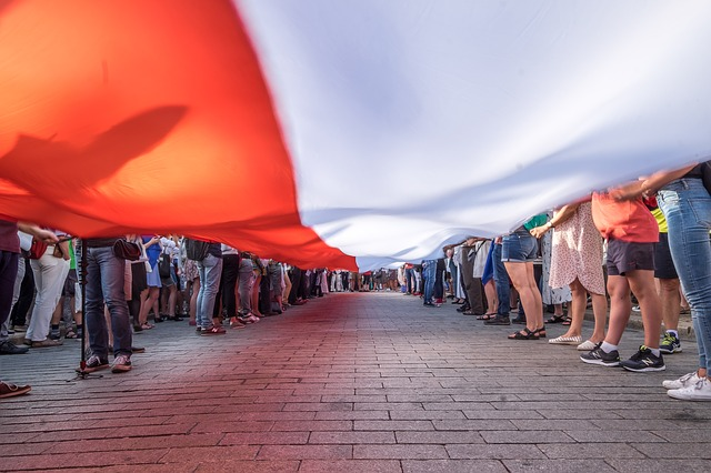 Polish flag held by a group of people